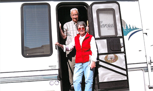 Jim and Shirley Pedersen posing in front of their 1998 26 1/2-foot Corsair 5th Wheel in Yuma, Arizona, while RVing from January to March, 2011.
