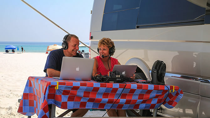 Mike and Jennifer prepare their podcast from the beach