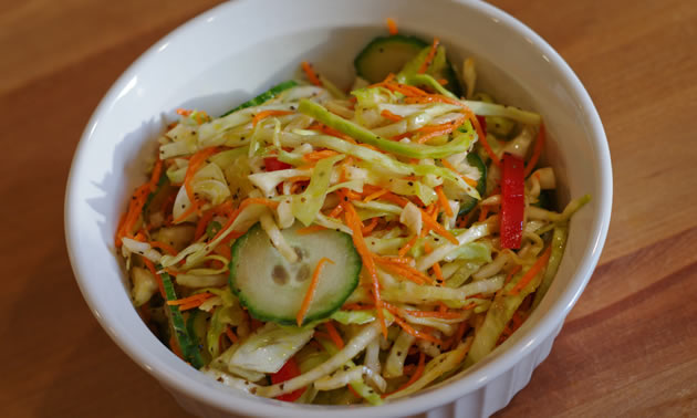 Crunchy coleslaw offsets the creamy fat of pulled pork.