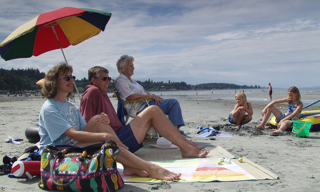 families lounging on the beach