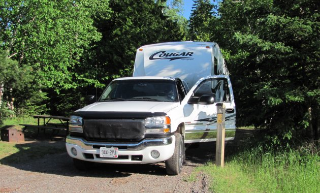 Our Cougar 5th wheel parked at a site at Rainbow Falls Prov. Park