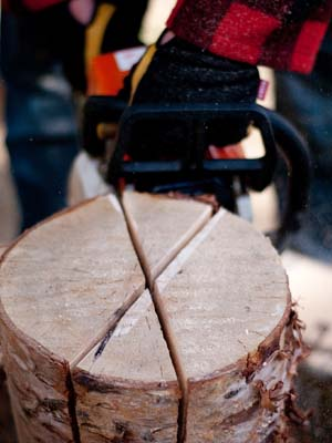 Three crisscross cuts half the length of the log,