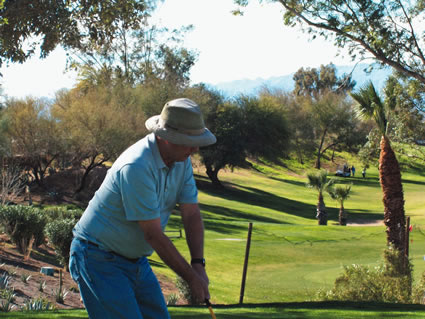 a golfer prepares to take a swing on a golf course