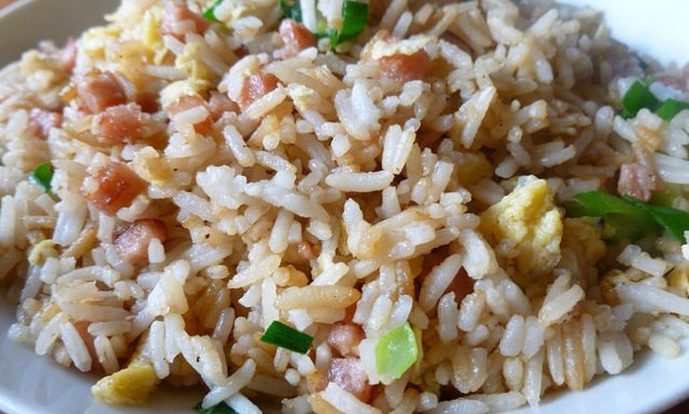 A close up photo of fried rice.