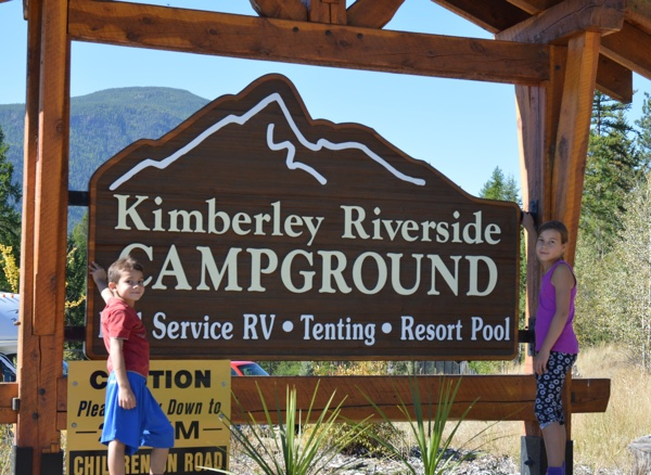 Daphne and Oliver Gonzalez standing next to the Kimberley Riverside Campground sign.