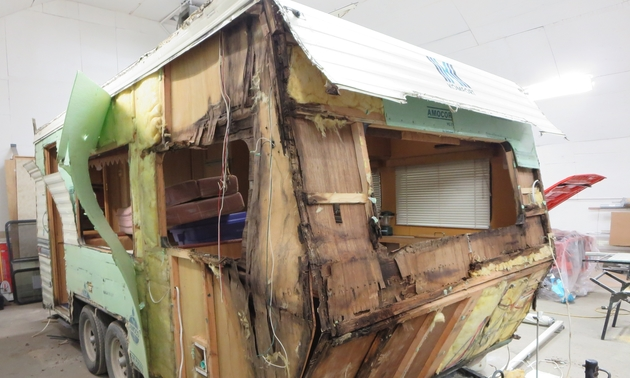 a rotting trailer falling apart