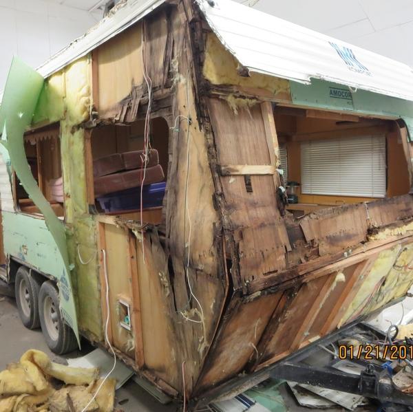 a rotting trailer falling apart