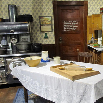 A kitchen with a vintage table and stove set with various utensils is one exhibit at the Western Development Museum in North Battleford.