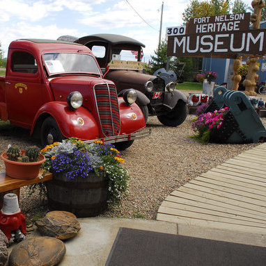 Antique cars and trucks are parked at the Fort Nelson Heritage Museum, which offers visitors a chance to learn about the building of the Alaska highway.