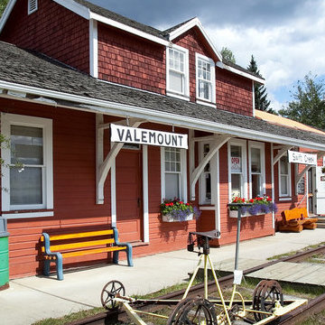 The front of the Valemount Museum is covered in red boards and has a bench on the front porch. It used to be the town's first train station.