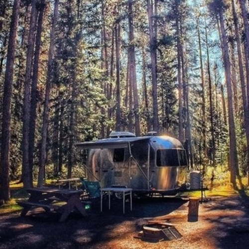Banff Alberta photo contest entry - RV in a treed in site