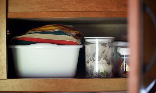 Storing items in bins makes it easier to access stored pieces and helps contain items during travel.