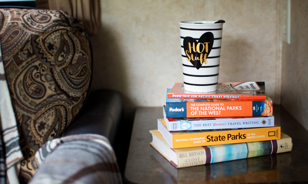 Colorful books and a fun coffee mug brighten up this space and avoid taking up cabinet storage.