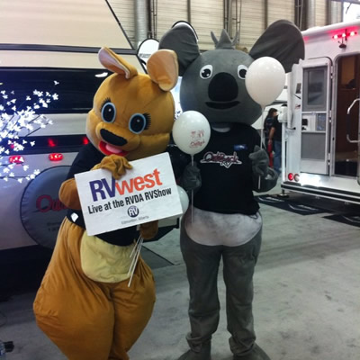 Having fun at the Edmonton RV show with the show mascots.