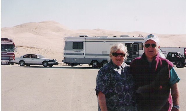 Carol and Don McDowall standing in front of their RV.