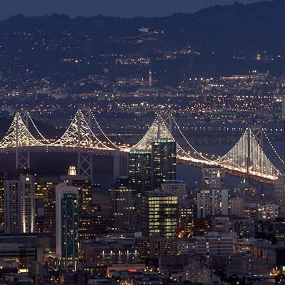 Picture of San Francisco-Oakland Bay Bridge lit up at night.