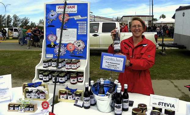 Barb Geisbrecht at the Fort St. John farmers market.  She is selling saskatoon jams, sauces, juice concentrate, candles, pie filling and pies.