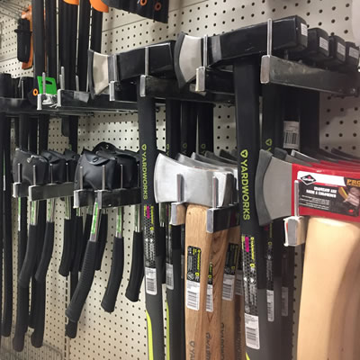A selection of axes at a hardware store.