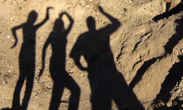 Glyn Jena and Haley's shadows thoroughly enjoy Rainbow Basin in Mojave Desert.