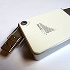 A white and silver shaver with a USB on it.