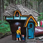 wooden house and figurines in forest