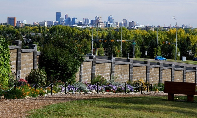 The Botanical Gardens of Silver Springs in Calgary with the city skyline far in the background.