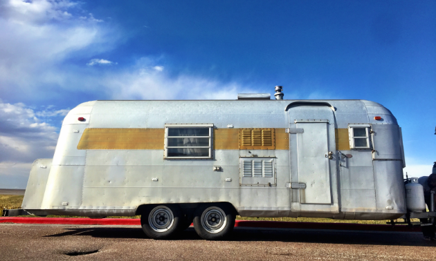 The Tin Can pulled over in a parking lot in Wyoming on our way to Yellowstone in September.