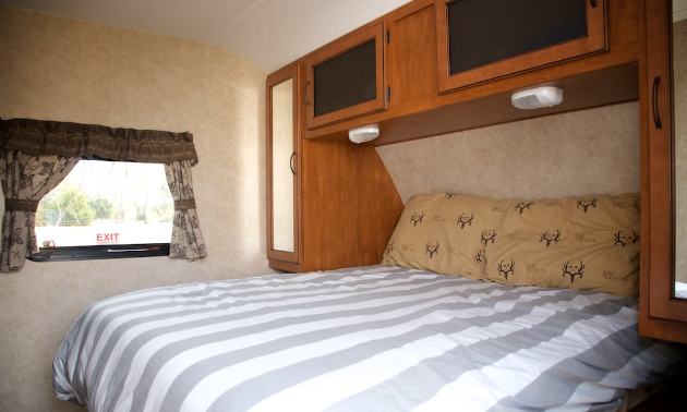 The queen bed in the Bryens' new 2013 camper.