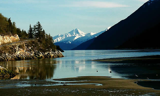 mountains and trees by a lake in Skagway