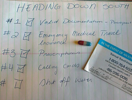 A checklist with a capsule and business card