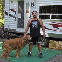 Greg Mykytiuk and his dog Bear enjoying the quiet campsite at Mount Fernie Provincial Park.