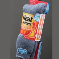 Grey Heat Holder socks in their package.