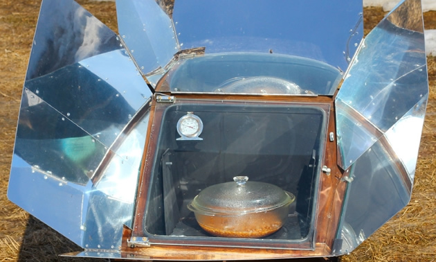 Solar oven cooking dinner.