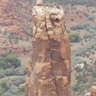 Two narrow rocks tower over a desert landscape