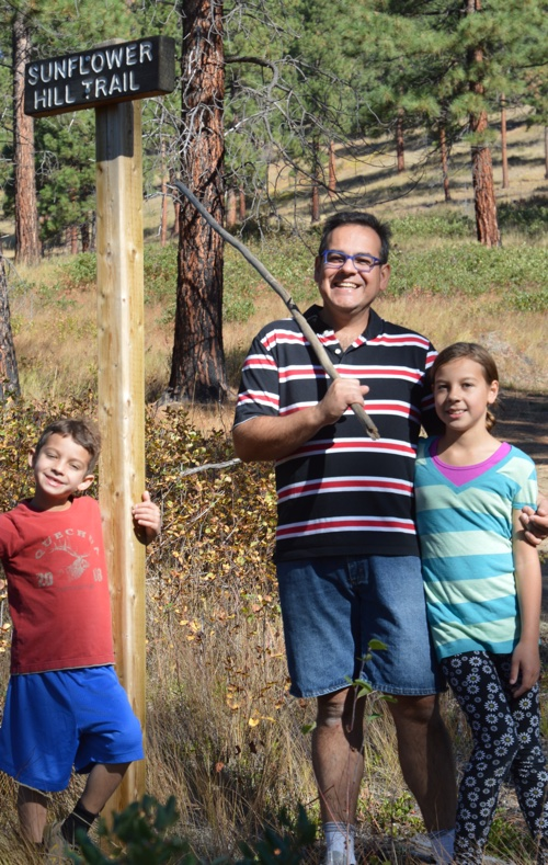 Jose Tomas, Daphne and Oliver Gonzalez starting out on a hike up sunflower hill.