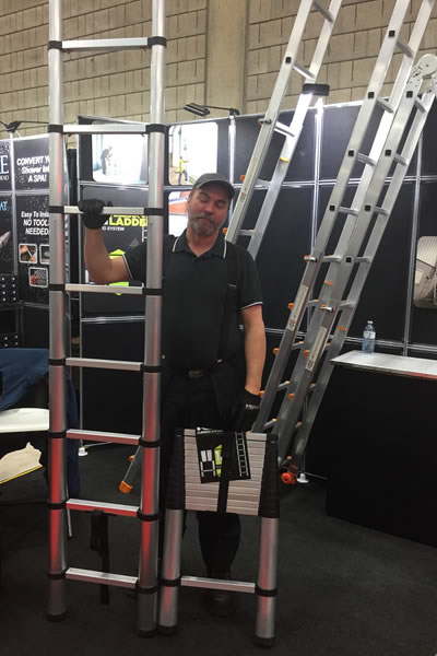 Dan Gauthier demonstrates the telescoping ladder fully extended and collapsed for transport and storage.