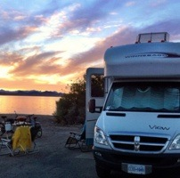 Patrick Tham's RV van with a sunset reflecting on the lake in the background.
