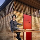 Isabella Mori on the porch of her tiny house, which she called Thousand Crows.