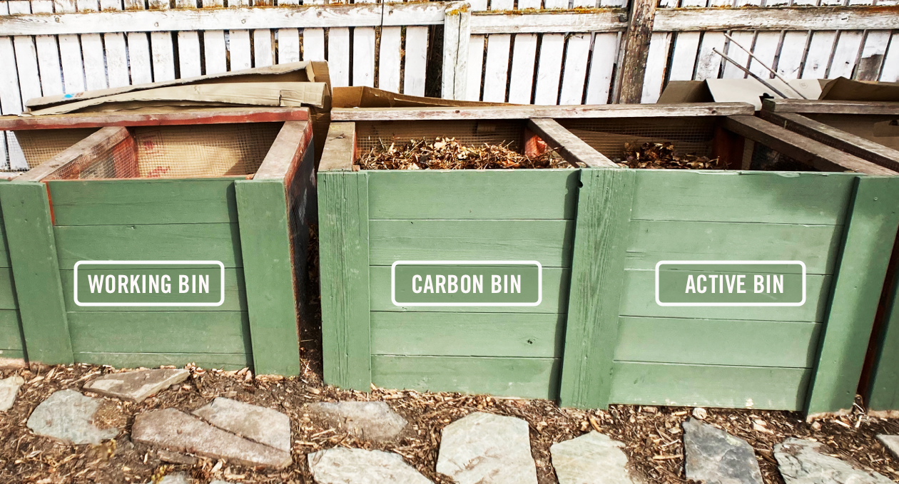 Three wooden bins filled with compost.