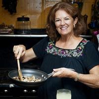 A photo of Tina of Tina's Cocina, cooking.