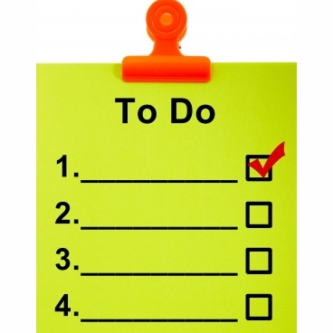 A To Do list in lime green, held up by a red clip.