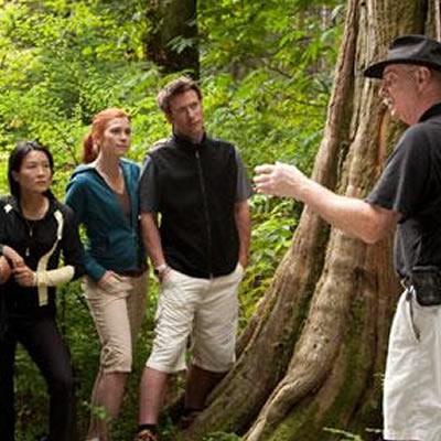 A man guiding a tourist group.