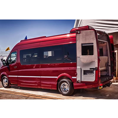 Picture of red RoadTrek RV.