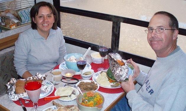 John and Teri Vallevand enjoy a turkey dinner in their motorhome at Elk Island National Park.