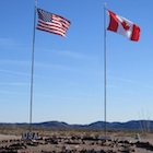 Canadian and American flags in the Valley of Names near Yuma, Arizona