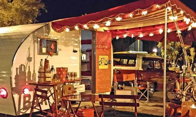 vintage RV with awning and lights
