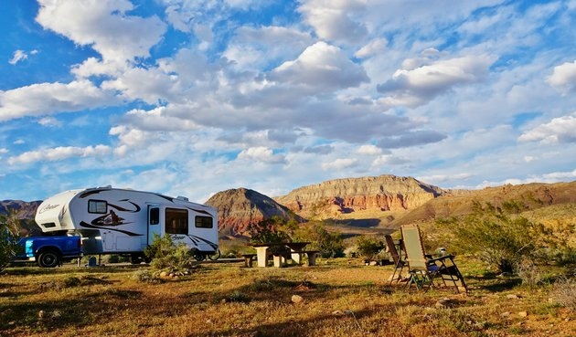 RV in Arizona with the mountains and sunny skies in background