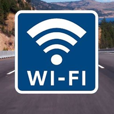A road sign with the wi-fi symbol on it.