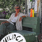 lady sitting on a bench in front of the Wildcat Cafe in Yellowknife, Northwest Territories