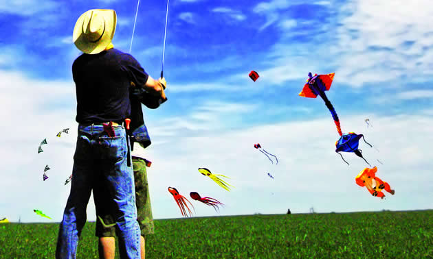 two people flying kites